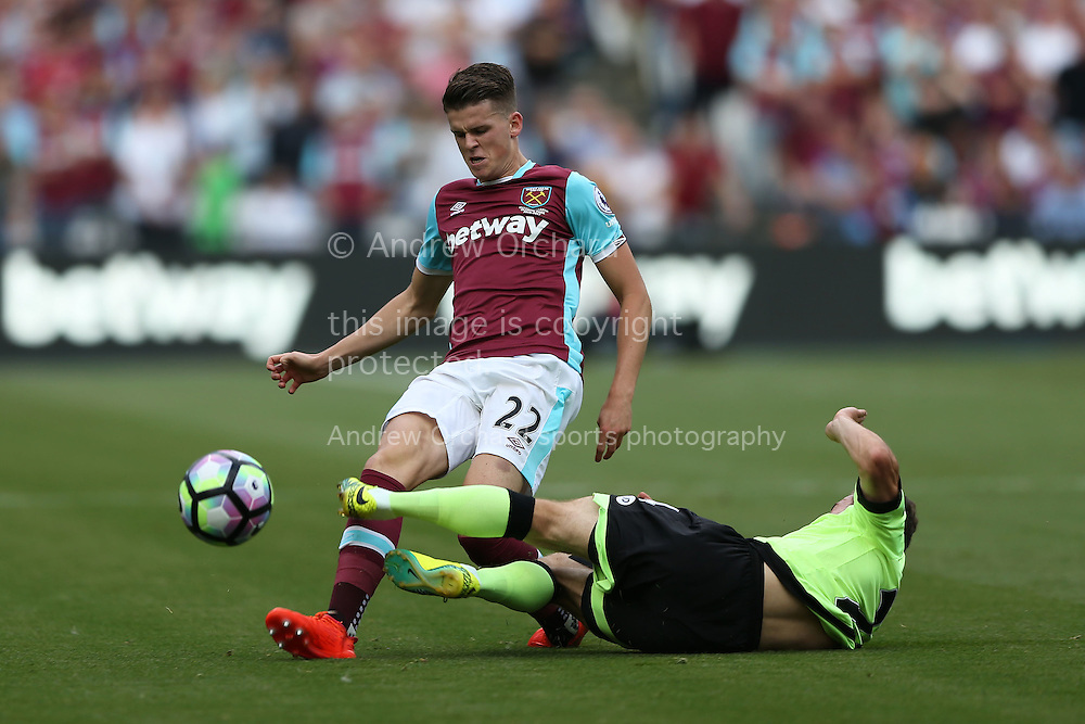 Ryan Fraser of Bournemouth tackles Sam Byram of West Ham United. Premier league match, West Ham Utd v AFC Bournemouth at the London Stadium, Queen Elizabeth Olympic Park in London on Sunday 21st August 2016.<br /> pic by John Patrick Fletcher, Andrew Orchard sports photography.