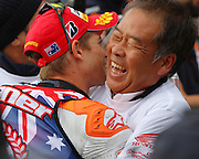World Moto GP Championship.<br /> Round16.Phillip Island.Australia.Sunday16.10.2011.<br /> #27 Casey STONER (AUS) Repsol Honda Team.<br /> Wins the race and is crowned the 2011 Moto GP Champion on his 26th birthday.<br /> Here fitted with the World Champion top hugging Nakamoto San (Vice president of Honda HRC).<br /> © ATP Photo/ Damir IVKA<br /> Motorrad-WM - MotoGP in Australien - Motorrad - Moto GP -Motorradsport - Grand Prix in Phillip Island - Motorcycle racing in Australia - Moto2 - 16.10.2011 - <br /> - fee liable image - Photo Credit: © ATP / Damir IVKA