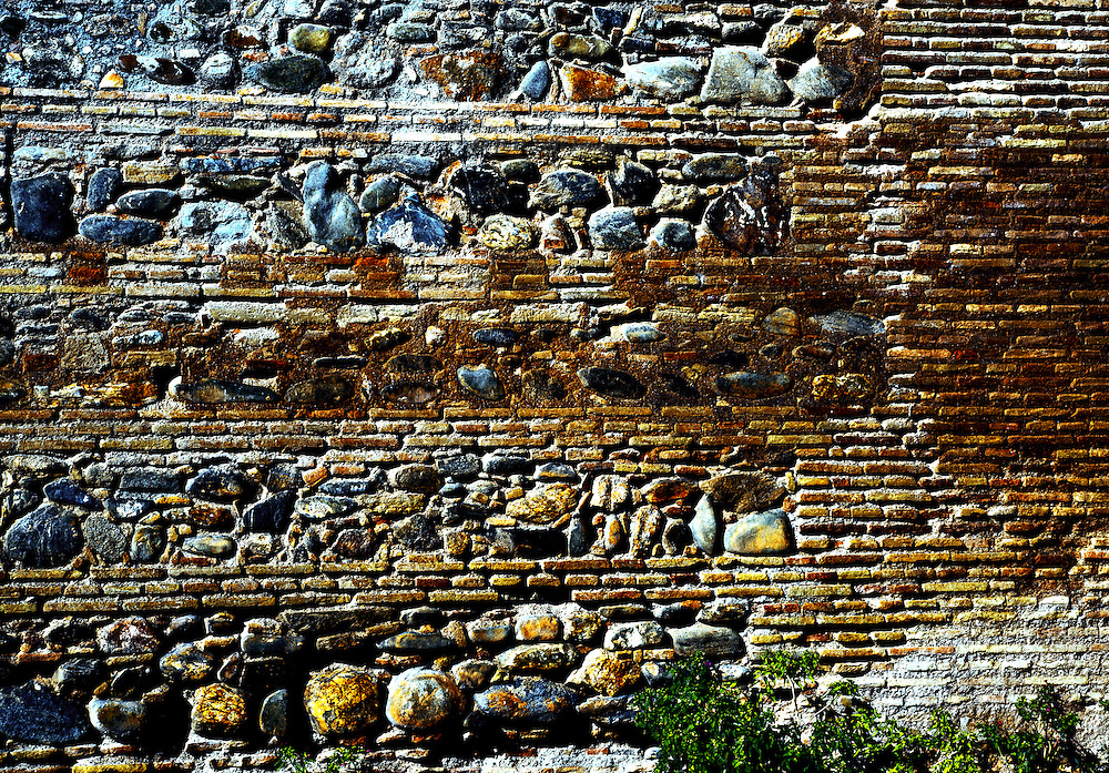 Brick wall with horizontal stripes or layers of stone masonry in the Alhambra