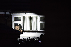 © Licensed to London News Pictures . 25/07/2017 . Oldham , UK . An upstairs window , illuminated at night by an exterior searchlight understood to be operated by police at the scene , is smashed and a duvet inserted through . Scene where an armed siege that began at 3.15am on Tuesday 25th July in a house on Pemberton Way in Shaw , is ongoing . A man named locally as Marc Schofield is reported to be holding a woman hostage after earlier releasing two children . The gas supply in the area has been cut off and several neighbouring properties have been evacuated . Photo credit : Joel Goodman/LNP