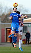 Danny Hollands wins a header during the Sky Bet League 2 match between Cheltenham Town and Portsmouth at Whaddon Road, Cheltenham, England on 20 December 2014. Photo by Alan Franklin.