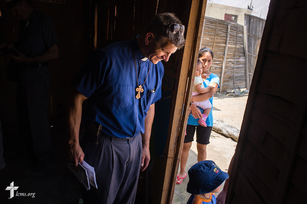 The Rev. Mark Eisold, LCMS career missionary to Peru, talks to residents in the landslide affected area of Huayaringa, Peru, on Tuesday, April 7, 2015. LCMS Communications/Erik M. Lunsford