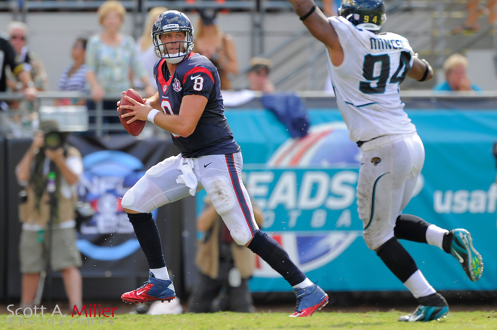 Houston Texans quarterback Matt Schaub (8) is pressured by Jacksonville Jaguars defensive end Jeremy Mincey (94) during the Texans 27-7 win at EverBank Field on September 16, 2012 in Jacksonville, Florida. ..©2012 Scott A. Miller..