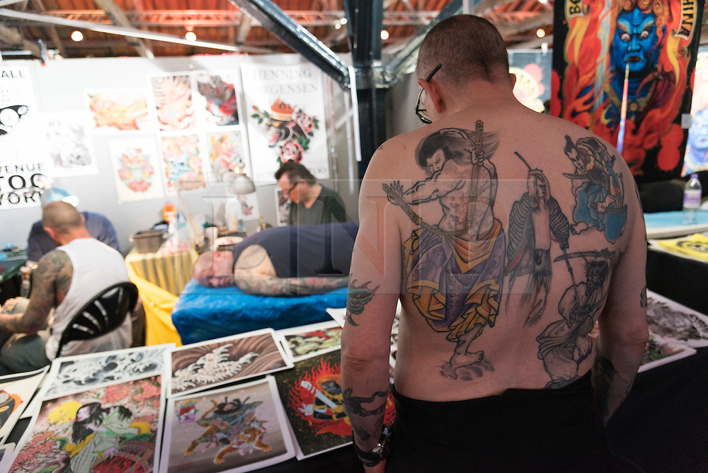 © Licensed to London News Pictures. 23/09/2016. Visitors walk around the stands at the12th International LOndon Tattoo Convention, London, UK. Photo credit: Ray Tang/LNP