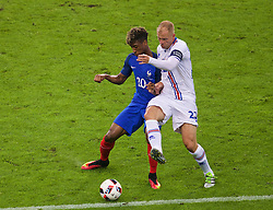 PARIS, FRANCE - Sunday, July 3, 2016: France's Kingsley Coman in action against Iceland's Eider Gudjohnsen during the UEFA Euro 2016 Championship Semi-Final match at the Stade de France. (Pic by Paul Greenwood/Propaganda)