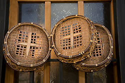 Asia, Japan, Honshu island, Kyoto, traditional woven baskets hang in restaurant window