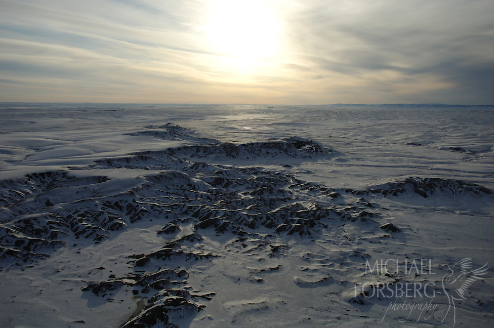 Pine Ridge Indian Reservation, South Dakota..Aerials over badlands and prairie in snow.