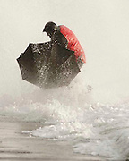 Locals brave the weather at Saltcoats, Ayrshire as the counrty is blasted by 90 mile per hour winds.