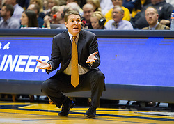 Jan 9, 2016; Morgantown, WV, USA; Oklahoma State Cowboys head coach Travis Ford argues a call during the first half against the West Virginia Mountaineers at the WVU Coliseum. Mandatory Credit: Ben Queen-USA TODAY Sports