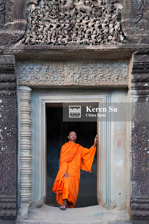 Monk at Angkor Wat, UNESCO World Heritage site.