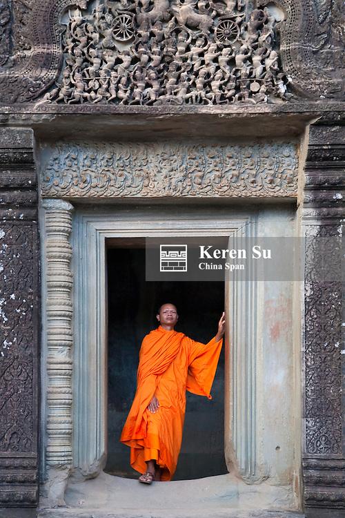 Monk at Angkor Wat, UNESCO World Heritage site.