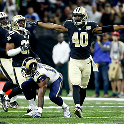 Nov 27, 2016; New Orleans, LA, USA;  New Orleans Saints cornerback Delvin Breaux (40) reacts after breaking up a pass to Los Angeles Rams wide receiver Kenny Britt (18) during the first half of a game at the Mercedes-Benz Superdome. Mandatory Credit: Derick E. Hingle-USA TODAY Sports