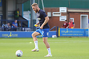 AFC Wimbledon midfielder Scott Wagstaff (7) warming up during the EFL Sky Bet League 1 match between AFC Wimbledon and Scunthorpe United at the Cherry Red Records Stadium, Kingston, England on 15 September 2018.