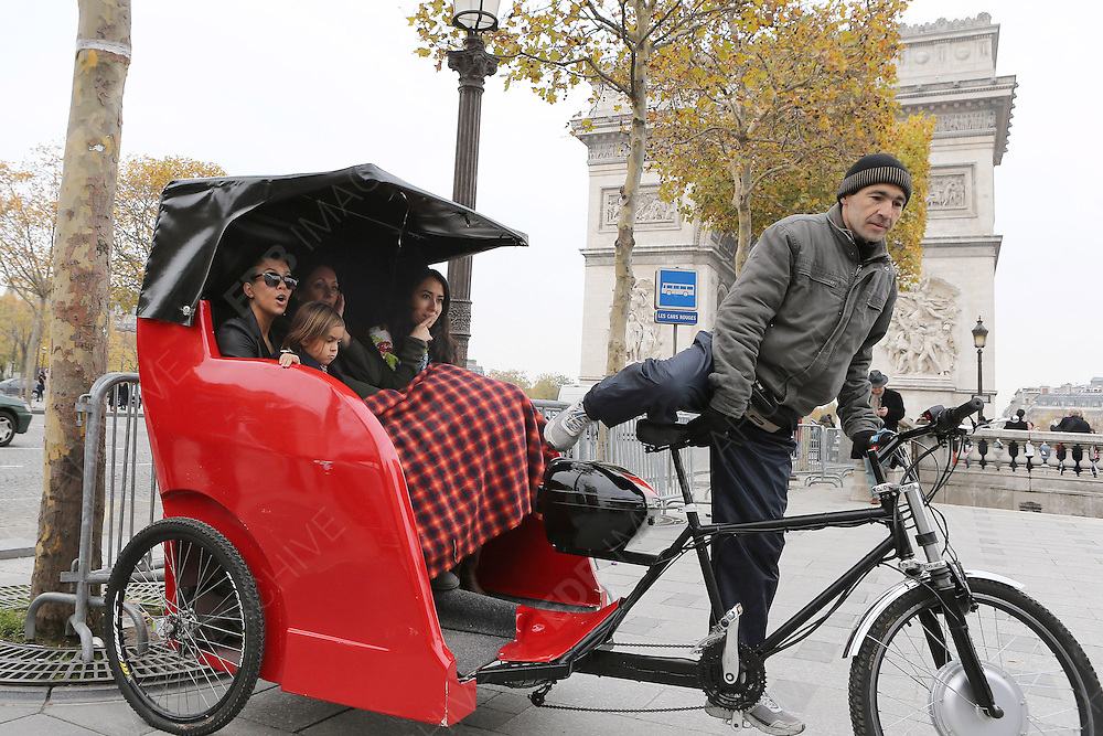 13.NOVEMBER.2012. PARIS<br /> <br /> KOURTNEY KARDASHIAN HER SON MASON AND FRIENDS ARE SPOTTED SPENDING THE DAY SIGHTSEEING IN PARIS. LEAVING THEIR HOTEL THEY WENT SHOPPING ON CHAMPS ELYSEES AVENUE AND THEN WENT ON A RICKSHAW BICYCLE AROUND PARIS MASON AT ONE POINT TRYING TO NAVIGATE A MAP.<br /> <br /> BYLINE: EDBIMAGEARCHIVE.CO.UK<br /> <br /> *THIS IMAGE IS STRICTLY FOR UK NEWSPAPERS AND MAGAZINES ONLY*<br /> *FOR WORLD WIDE SALES AND WEB USE PLEASE CONTACT EDBIMAGEARCHIVE - 0208 954 5968*
