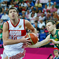 08 August 2012: Russia Victor Khryapa drives past Lithuania Martynas Pocius during 83-74 Team Russia victory over Team Lithuania, during the men's basketball quarter-finals, at the 02 Arena, in London, Great Britain.
