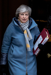 "© Licensed to London News Pictures. 13/03/2019. London, UK. Prime Minister Theresa May leaves 10 Downing Street on her way to Parliament for Prime Minister's Questions. MPs will vote on whether to remove the option of a ""no deal"" departure from the EU today, after Prine Minister Theresa May's proposed deal was defeated for a second time last night. Photo credit: Rob Pinney/LNP"