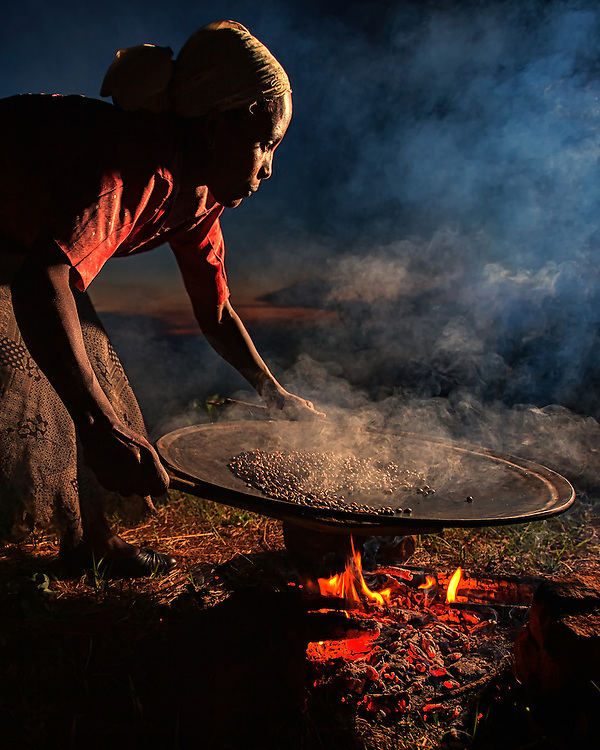 Coffee is washed, roasted, ground, and dried daily in the Ethiopian coffee ceremony, performed here after sunset in the Limu region of Ethiopia.