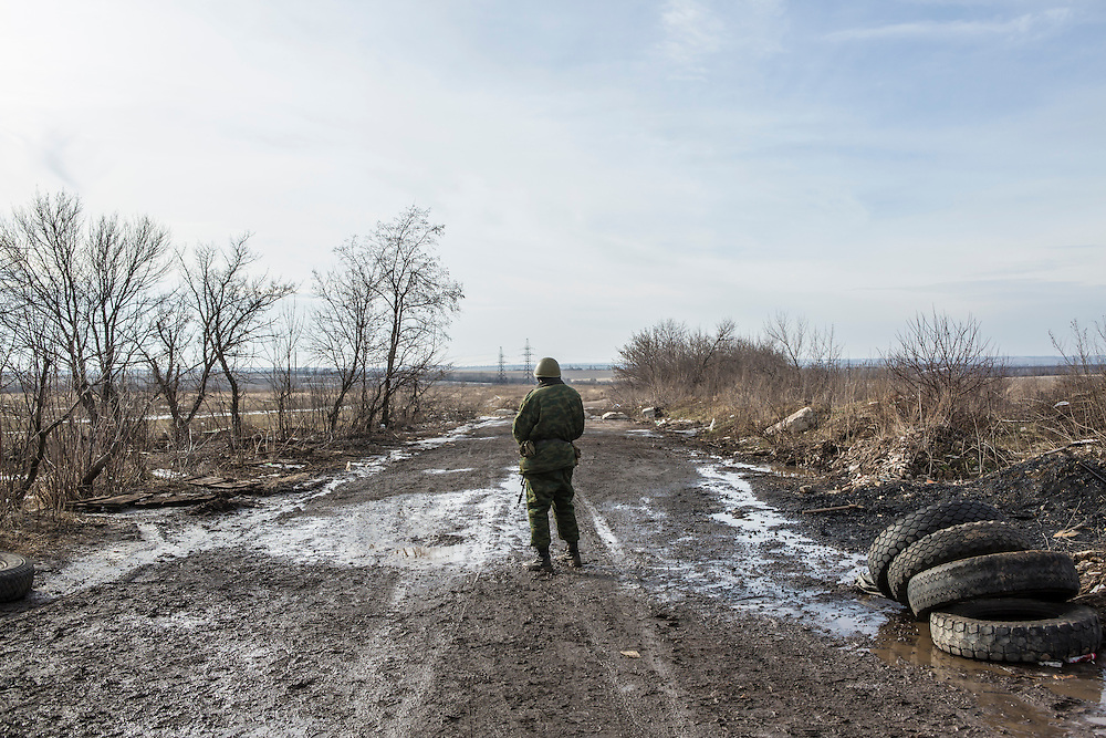 GORLOVKA, UKRAINE - JANUARY 31, 2015: A rebel fighter looks in the direction of Ukrainian forces at a front-line position in Gorlovka, Ukraine. Fighting in Ukraine has intensified over the last week, with rebels declaring the end of a September ceasefire. CREDIT: Brendan Hoffman for The New York Times