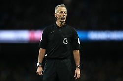 Match referee Martin Atkinson during the Premier League match at the Etihad Stadium, Manchester.