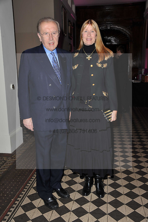 SIR DAVID & LADY CARINA FROST at a fashion show by Catherine Walker & Co in support of The Haven held at One Mayfair, North Audley Street, London on 18th May 2011.