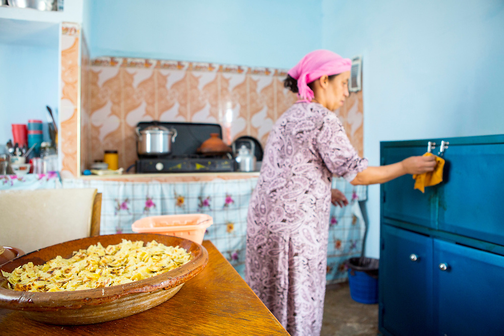 Berber lady prepares rfissa at her home in Azrou, Middle Atlas region of Morocco