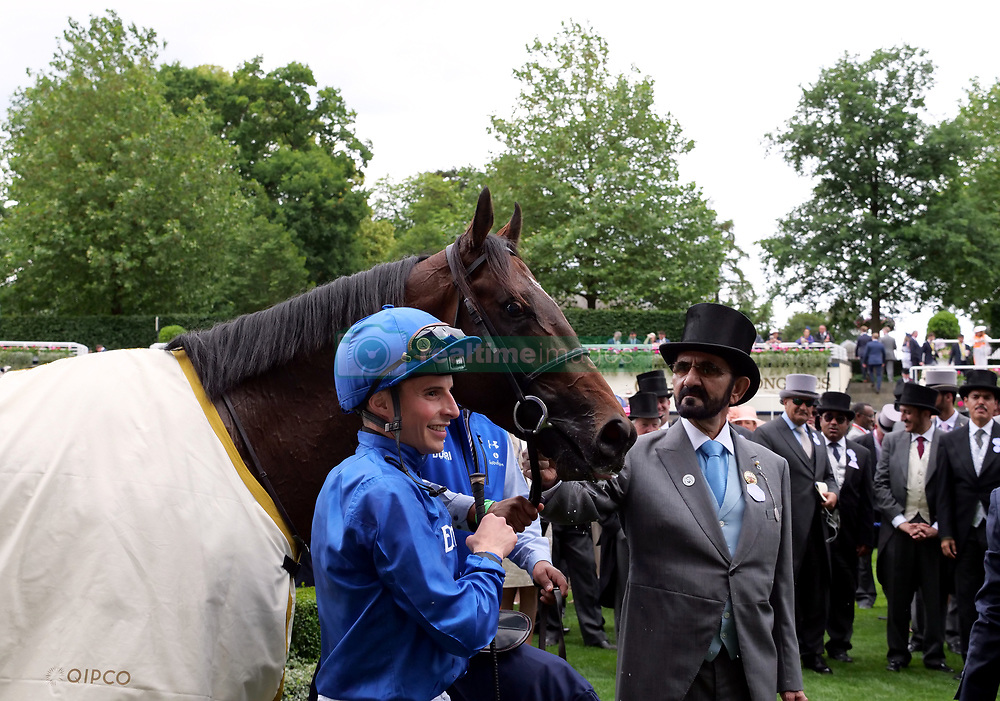 Sheikh Mohammed bin Rashid Al Maktoum and jockey William Buick during day one of Royal Ascot at Ascot Racecourse.