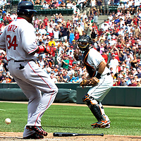 09 September 2007:  Boston Red Sox designated hitter David Ortiz (34) scores on a single by third baseman Mike Lowell that also brought in second baseman Dustin Pedroia in the 3rd inning as Baltimore Orioles catcher Ramon Hernandez (55) looks to retrieve the errant throw.  The Red Sox defeated the Orioles 3-2 at Camden Yards in Baltimore, MD.  ****For Editorial Use Only****