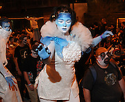 Participants in the annual All Souls Procession march through downtown Tucson, Arizona, USA to honor the deceased.