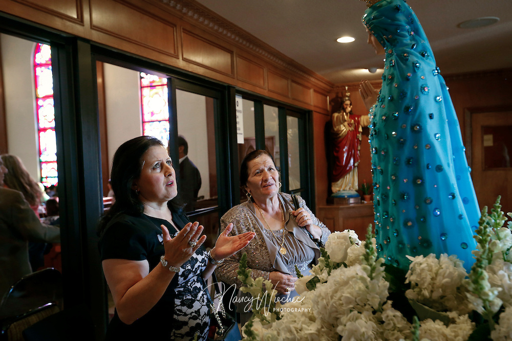 Women stop to pray in the vestibule of St. Peter Chaldean Catholic Cathedral in El Cajon, Calif., Aug. 14, 2015.  (Nancy Wiechec for ONE magazine)