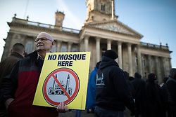 "© Licensed to London News Pictures . 26/11/2016 . Bolton , UK . Those opposed to mosques pictured at the demonstration . Approximately 100 people attend a demonstration against the construction of mosques in Bolton , under the banner "" No More Mosques "" , organised by a coalition of far-right organisations and approximately 150 anti fascists opposing the demonstration , in Victoria Square in Bolton Town Centre . Photo credit : Joel Goodman/LNP"