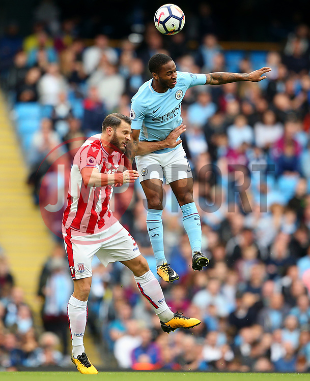 Raheem Sterling of Manchester City challenges Erik Pieters of Stoke City - Mandatory by-line: Matt McNulty/JMP - 14/10/2017 - FOOTBALL - Etihad Stadium - Manchester, England - Manchester City v Stoke City - Premier League