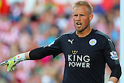 Leicester City's Kasper Schmeichel instructing his players during the Barclays Premier League match between Stoke City and Leicester City at the Britannia Stadium, Stoke-on-Trent, England on 19 September 2015. Photo by Aaron Lupton.