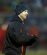 Solon head coach Kevin Miller warms up with his team before the start of the first half of the game between the Solon Spartans and the Marion Indians at Thomas Park Field in Marion on Friday evening, October 5, 2012.