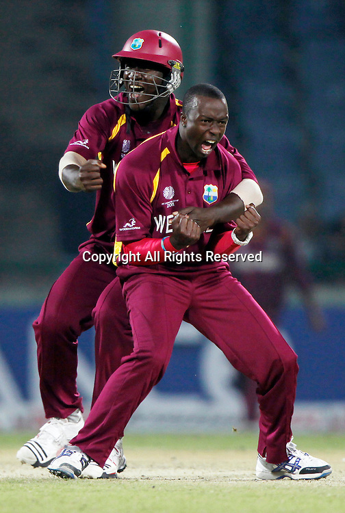 28.02.2011 Cricket World Cup from the Feroz Shah Kotla stadium in Delhi. West indies v Netherlands. Kemar Roach of West Indies celebrates the wicket as he took a hatric during the match of the ICC Cricket World Cup between Netherlands and West Indies on the 28th February 2011