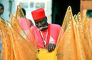 "Trinidad and Tobago ""MOKO JUMBIES: The Dancing Spirits of Trinidad"".(Moko Jumbie Tion Dopwell fixes the wings of a costume for a parade. ).A photo essay about a stilt walking school in Cocorite, Trinidad..Dragon Glen de Souza founded the Keylemanjahro School of Art & Culture in 1986. The main purpose of the school is to keep children off the streets and away from drugs..He first taught dances like the Calypso, African dance and the jig with his former partner Cathy Ann Samuel.  Searching for other activities to engage the children in, he rediscovered the art of stilt-walking, a tradition known in West Africa as the Moko Jumbies , protectors of the villages and participants in religious ceremonies. The art was brought to Trinidad by the slave trade and soon forgotten..Today Dragon's school has over 100 members from age 4 and up..His 2 year old son Mutawakkil is probably the youngest Moko Jumbie ever. The stilts are made by Dragon and his students and can be as high as 12-15 feet. The children show their artistic talents mostly at the annual Carnival, which today is unthinkable without the presence of the Moko Jumbies. A band can have up to 80 children on stilts and they have won many of the prestigious prizes and trophies that are awarded by the National Carnival Commission. Designers like  Peter Minshall , Brian Mac Farlane and Laura Anderson Barbata create dazzling costumes for the school which are admired by thousands of  spectators. Besides stilt-walking the children learn the limbo dance, drumming, fire blowing and how to ride  unicycles..The school is situated in Cocorite, a suburb of Port of Spain, the capital of Trinidad and Tobago..all images © Stefan Falke"
