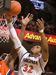 Virginia forward Mike Scott (32) grabs a rebound against Clemson.  The Virginia Cavaliers defeated the #12 ranked Clemson Tigers in overtime 85-81 at the John Paul Jones Arena on the Grounds of the University of Virginia in Charlottesville, VA on February 15, 2009.
