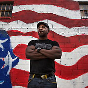 BALTIMORE, MD - FEB23: Chris Wilson, 38, a business owner in Baltimore, stands outside the One Twenty studio in the Station North arts district in Baltimore, MD, where his company built partition walls to divide the artist's space inside. Wilson went to prison at age 17 for murder, but got his associates degree while in prison and was able to attend the University of Baltimore after his release. He testified in Annapolis about the ban the box movement in Maryland which would remove the question about a person's criminal history from college applications.(Photo by Evelyn Hockstein/For The Washington Post)