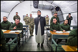 Imam Asim Hafiz  helps Afghan Army Troops with their studies while on a visit to  Camp Qargha in Kabul, 19th January 2014 . Picture by Andrew Parsons / Parsons Media Ltd
