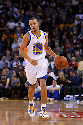Feb 2, 2012; Oakland, CA, USA; Golden State Warriors point guard Stephen Curry (30) dribbles the ball against the Utah Jazz during the second quarter at Oracle Arena. Golden State defeated Utah 119-101. Mandatory Credit: Jason O. Watson-US PRESSWIRE