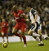 Photo: Aidan Ellis.<br /> Liverpool v Tottenham Hotspur. The Barclays Premiership.<br /> 14/01/2006.<br /> Liverpool's Djibril Cisse battles with Spurs Paul Stalteri