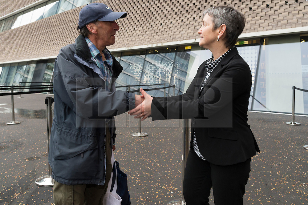 © Licensed to London News Pictures. 17/06/2016. The first member of the public in the queue, Ray Cunnick aged 65 is greeted by Frances Morris, director of the Tate Modern on the first public opening day of the Tate Modern Switch House extension. The new ten-story building offers 60% more space and a 360-degree views of the River Thames, St Paul's Cathedral and the dramatic London skyline.  London, UK. Photo credit: Ray Tang/LNP