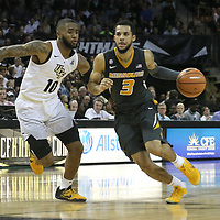 ORLANDO, FL - NOVEMBER 30: Kassius Robertson #3 of the Missouri Tigers dribbles past Dayon Griffin #10 of the UCF Knights during a NCAA basketball game at the CFE Arena on November 30, 2017 in Orlando, Florida. (Photo by Alex Menendez/Getty Images) *** Local Caption *** Kassius Robertson; Dayon Griffin