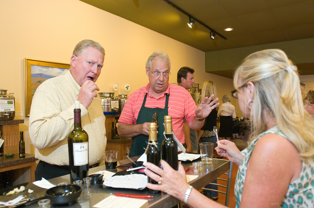 Owner Bob Hundley, center, offers a sample of four-leaf Aragosta Balsamic Vinegar to Tony, left, and Val Manley during a tasting event of flavored olive oils and traditional and white balsamic vinegars at Primo Oils and Vinegars in their store at 3628 Brownsboro Road,Tuesday, Aug. 21, 2012 in Louisville, Ky. (Photo by Brian Bohannon)
