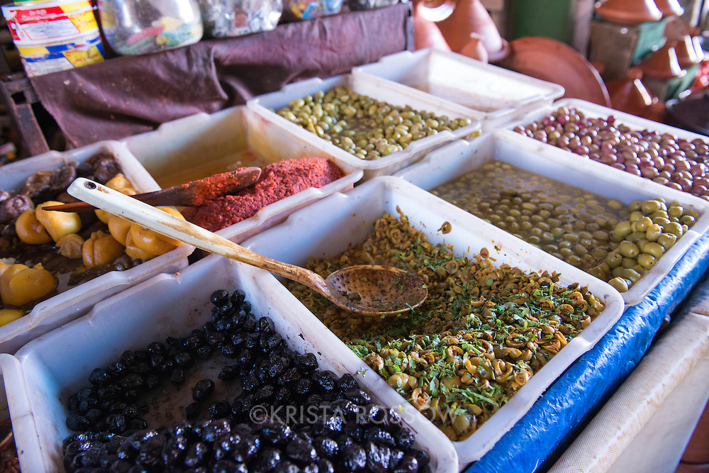 A variety of olives for sale at one of the market stalls in the Medina of Marrakesh, Morocco.