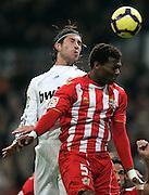 Real Madrid's Sergio Ramos against Almeria's Kalou Uche during La Liga match, November 05, 2009.