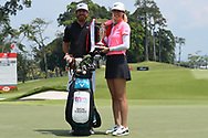 SINGAPORE - MARCH 04: Michelle Wie (USA) and her caddie with the trophy during the presentation after the final round at the HSBC Women's World Championship 2018 at Sentosa Golf Club, Singapore on March 04, 2018.<br /> .<br /> .<br /> .<br /> (Photo by: Naratip Golf Srisupab/SEALs Sports Images)<br /> .<br /> Any image use must include a mandatory credit line adjacent to the content which should read: Naratip Golf Srisupab/SEALs Sports Images