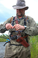 Fishing for Dolly Vardens on the Alaska Penisula while carrying a handgun for bear protection.