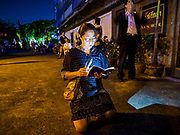 30 MARCH 2018 - BANGKOK, THAILAND: A woman kneels on the pavement and prays during the Stations of the Cross procession during Good Friday observances at Santa Cruz Church in the Thonburi section of Bangkok. Santa Cruz Church is more than 350 years old and is one of the oldest Catholic churches in Thailand. Good Friday is the day that most Christians observe as the crucifixion of Jesus Christ. Thailand has a small Catholic community.       PHOTO BY JACK KURTZ