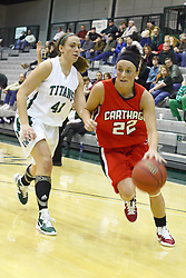 29 January 2011: Heather Gilmore rushes past Karen Solari during an NCAA Womens basketball game between the Carthage Reds and the Illinois Wesleyan Titans at Shirk Center in Bloomington Illinois.