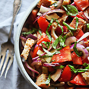This classic tomato panzanella recipe is the updated version with summer tomatoes and crouton-like bread cubes. Feel free to experiment: use different kinds of breads and vegetables, stir in cheeses like mozzarella, parmesan or feta or add other new ingredients like olives, capers, hard-boiled eggs, pine nuts or whatever else you like in a salad.